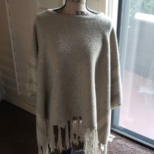 Poncho. Beige color with fringe at the bottom